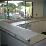 Hi-Macs Countertop with Elevated Avonite Bar